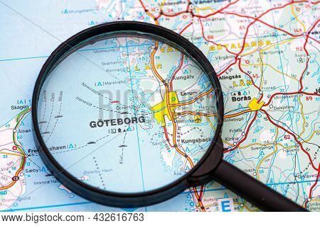 Map Of Gothenburg In Sweden Through Magnifying Glass, Concept Of Planning The Travel Itinerary
