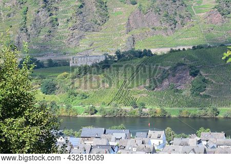 View Across The Mosel Valley With A Village On One Side Of The River And A Ruin On The Other