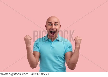 Happy Surprised Bald Homosexual Man With Bristle Won A Prize, Screams In Excitement, Has Mouth Wide