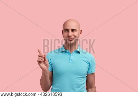 Interested Bald Homosexual Man With Bristle Indicates Aside With Index Finger, Shares A Secret, Relu