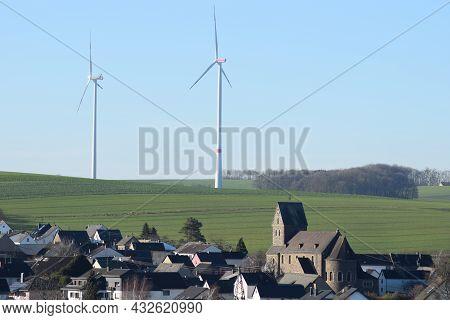 Alzheim, Germany - 01 06 2021: Village Alzheim, Part Of Mayen With Wind Power Background