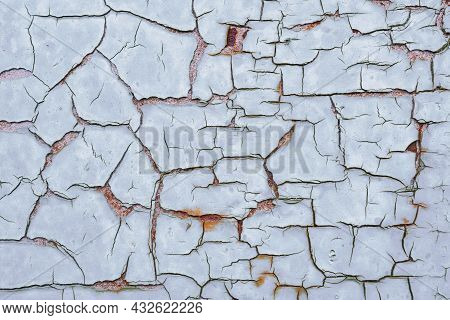 Cracked Light Gray-blue Paint On A Rusty Iron Surface. Abstract Grey Tinted Background Or Backdrop.