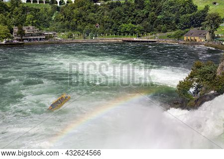 Mighty White Rapids Of The Rhine River At The Rhine Falls, The Famous And Biggest Waterfall In Europ