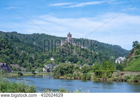 View On Mosel River, Hills With Vineyards And Castle In Old Town  Cochem, Germany, Germany