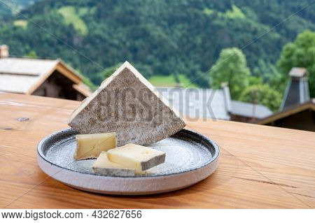 Cheese Collection, French Cheese Tomme De Savoie And French Mountains Village In Haute-savoie On Bac