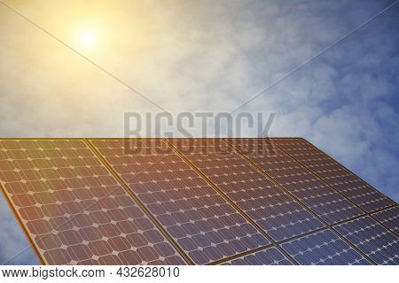 Photovoltaic Solar Power Panel On Blu Sky With White Clouds Background. Solar Panel In Sunlight. Alt
