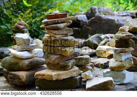 Zen Stones, Stones Stacked In A Column Against The Background Of The Forest, Stones Stacked In A Fig