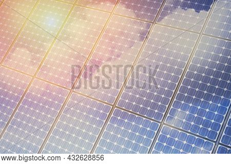 Reflection Sun And Blue Sky With White Clouds In Photovoltaic Solar Power Panel. Solar Panel In Sunl