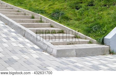 Steps From Paving Slabs And Curbs. Rows Of Gray Steps Made Of Gray Paving Slabs Are Laid Out Evenly,