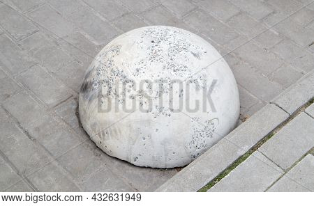 Round Concrete Road Parking Block In The Shape Of A Hemisphere To Prevent Cars From Parking Here. Ar