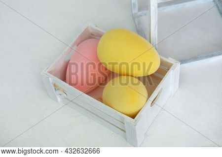 Easter Yellow And Pink Eggs In Wooden Box On White Background. Colorful Easter Ostrich Eggs. Decorat
