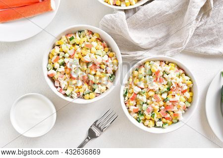 Russian Style Imitation Crab Salad With Crab Sticks, Corn, Eggs, Cucumber And Rice. White Background