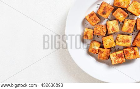 Pan Fried Paneer. Indian Roasted Cottage Cheese Bites On Plate Over White Background With Free Text