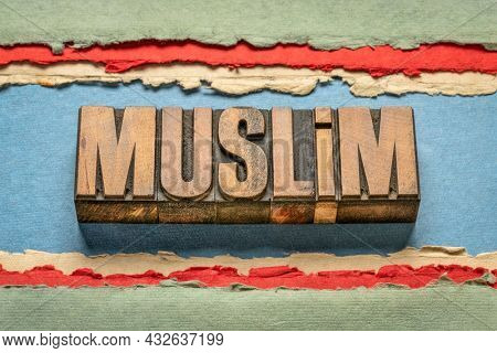 Muslim word abstract in vintage letterpress wood type, a follower of Islam religion
