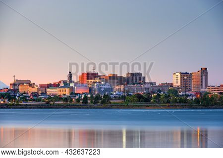 Portland, Maine, USA downtown skyline from Back Cove at twilight.
