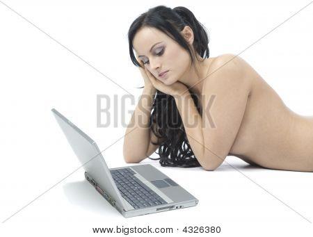 Beautiful Nude Brunette Homeworker Using Her Laptop