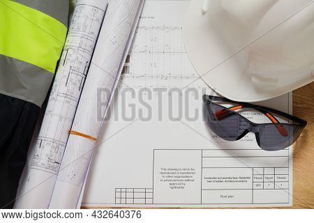 White Hardhat, Blueprints And Protective Eyeglasses. Workplace Of Engineer. Set Of Engineering Drawi