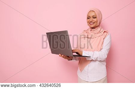 Isolated Portrait On Pink Background With Space For Text Of A Successful Middle Aged Muslim Beautifu