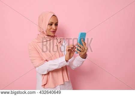 Isolated Portrait Of Confident Arab Muslim Mature Pretty Woman In Strict Religious Outfit And Covere