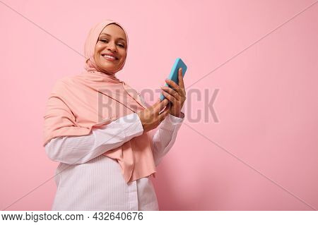Smiling With Toothy Smile Mature Muslim Woman Of Middle Eastern Ethnicity In Colored Hijab With Smar