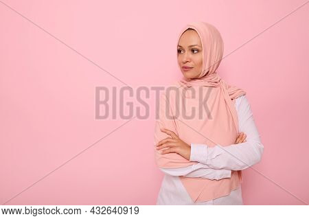 Confident Portrait Of Arabic Muslim Beautiful Woman With Attractive Gaze And Covered Head With Pink