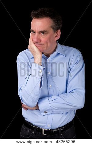 Angry Frowning Business Man With Hand To Chin