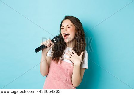Carefree Beautiful Girl Perform Song, Singing In Microphone With Passion, Playing Karaoke, Standing