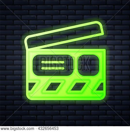 Glowing Neon Movie Clapper Icon Isolated On Brick Wall Background. Film Clapper Board. Clapperboard