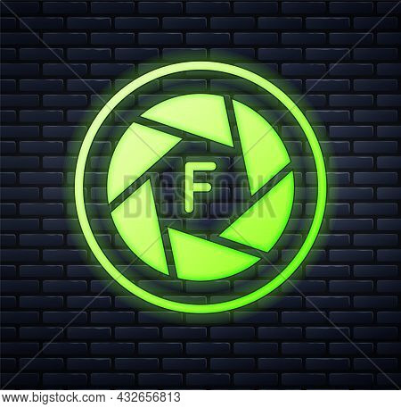 Glowing Neon Camera Shutter Icon Isolated On Brick Wall Background. Vector