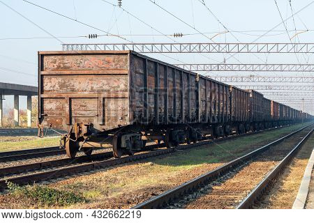 Old Rusty Freight Wagons At The Marshalling Yard.