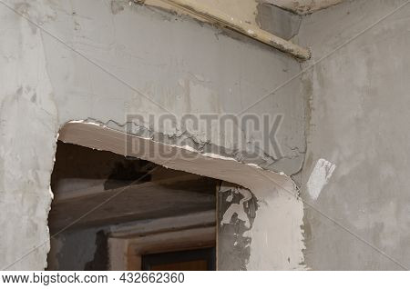 Repair And Construction Services Concept. Gray Plastered Walls And Doorway. Room Renovation. Selecti