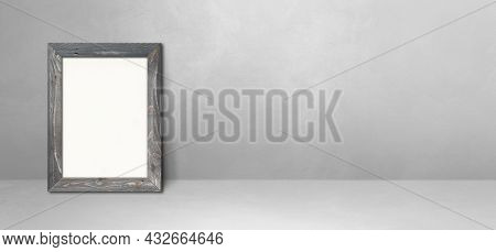 Wooden Picture Frame Leaning On A Light Grey Wall. Blank Mockup Template. Horizontal Banner