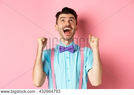 Relieved And Happy Man Thanking God, Looking Up In Sky While Celebrating Victory, Winning Prize And