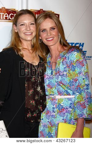 LOS ANGELES - MAR 12:  Anna Torv, Rebecca Mader arrive at the