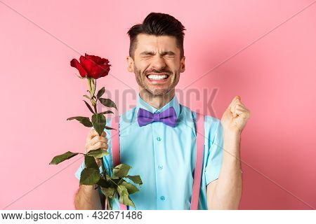 Romance And Valentines Day Concept. Hopeful Man Feeling Excited Before Date, Waiting For Lover With
