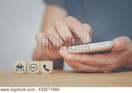 Online Delivery And Service Icon With Blurred Senior Human Hand Holding White Smart Phone For Suitab