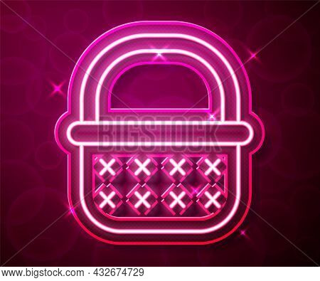 Glowing Neon Line Wicker Basket Icon Isolated On Red Background. Vector