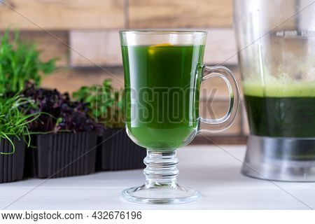 Microgreen Juice On The Kitchen Table. Micro Greens In A Blender. Make A Microgreen Smoothie At Home