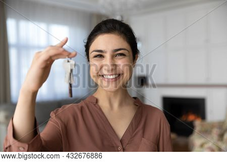 Excited Indian Female Become Homeowner Look At Camera Hold Key