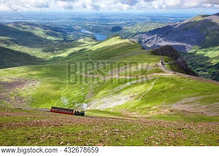 Mountain railway, Snowdonia, North Wales. The steam train runs from the town of LLanberis in the valley to the summit of Mount Snowden. Rural landscape in spring.