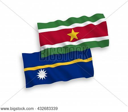 National Fabric Wave Flags Of Republic Of Nauru And Republic Of Suriname Isolated On White Backgroun