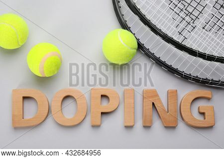 Word Doping, Tennis Rackets And Balls On Light Grey Background, Flat Lay