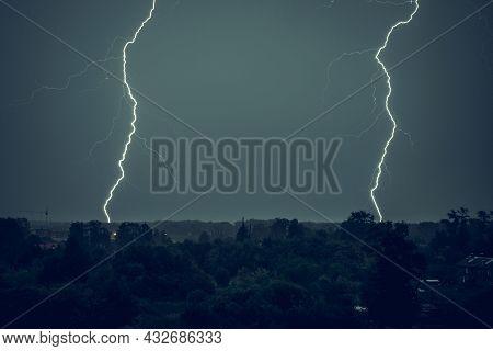 Lightning Strike In The Dark Night Sky. Summer Thunderstorm.