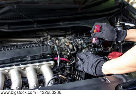Technician Use Screwdriver Remove A Bolt Of Airflow Sensor In The Engine Room Car For Check And Clea