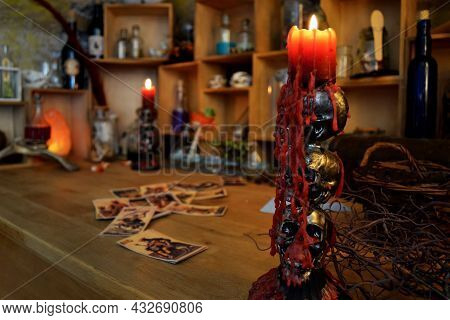 Table With Magical Props, Halloween Background With Skull Candelabra With Foreground.