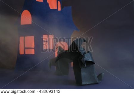 Figures Of Two Dark Ghosts With A Red Glow In The Fog Against The Background Of A Dark House. Black