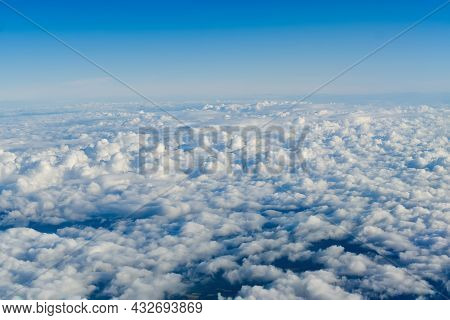 View Of The Sky Above The Clouds. Blue Sky High View From Airplane Window Clouds Shapes. Sky-clouds