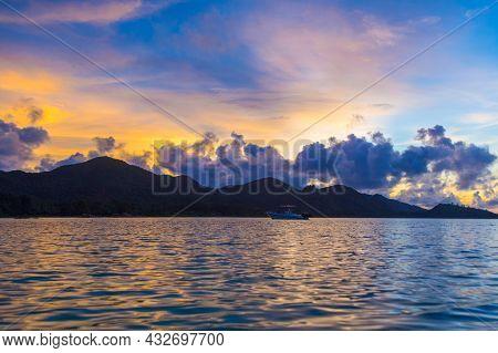 Sea, Boat And Mountain At Sunset On Praslin Island, Seychelles.
