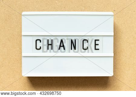 Lightbox With Word Chance On Wood Background