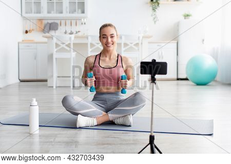 Cheerful European Millennial Blonde Female Fitness Blogger Look At Webcam And Make Video Of Training